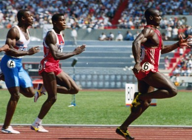 Johnson (right) leads Carl Lewis and Linford Christie at the Seoul Olympics.