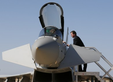 File photo of Prime Minister David Cameron speaks to an airman in the cockpit of a Typhoon fighter jet.
