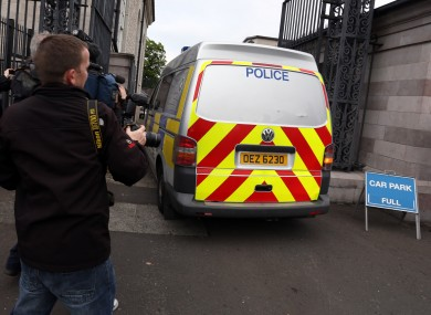 A police van transporting Leslie Ross, arrives at Armagh court in Northern Ireland where he was been charged with the murders of Michelle Bickerstaff and Margaret Weise last week.