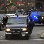 Boston law enforcement vehicles drive to the scene near where Dzhokhar Tsarnaev was thought to be hiding in Watertown. (AP Photo/Massachusetts State Police, Sean Murphy)<span class=