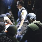 The emergency medical team tending to the marathon bombing suspect.  (AP Photo/Massachusetts State Police, Sean Murphy)<span class=