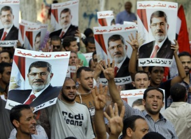 Mohammed Morsi supporters in Cairo yesterday