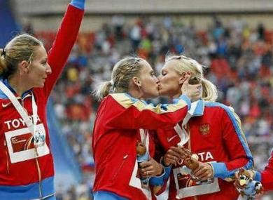 Ksenia Ryzhova and Yulia Gushchina embrace on the podium.