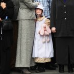 Lauren Power, 5, dressed in costume from 1913.<span class=