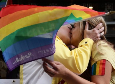 People taking part in a kiss-in protest outside the Russian Consulate in Vancouver