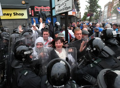 Police clash with loyalist protestors in Belfast city centre as they attempted to block part of the route the Anti-Internment League parade.