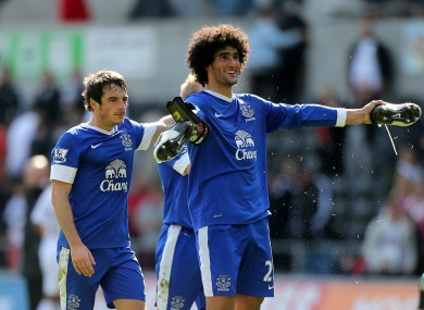 Everton pair Fellaini (right) and Baines.