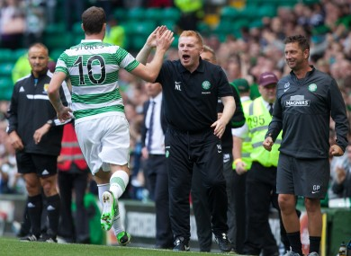 Stokes and Lennon celebrate Celtic's late winner.