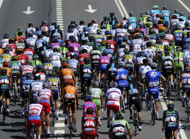 The pack rides outside Monforte de Lemos during the fifth stage of the Vuelta.