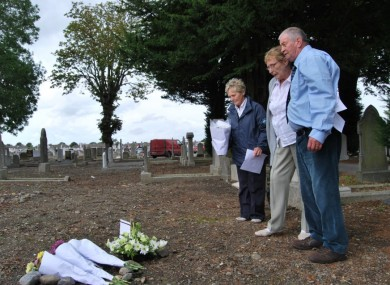 Derek (right) with his wife Carol and fellow survivors group member Noeleen at Mount Jerome cemetery.