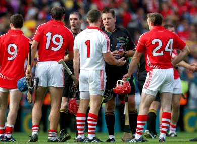 Question time: Cork's players speak to referee Brian Gavin at the final whistle.
