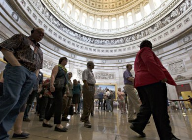 With hours to go until a possible government shutdown, visitors tour the Rotunda of the Capitol in Washington DC.