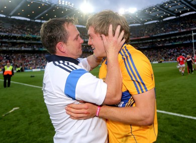 Clare's manager Davy Fitzgerald and Shane O'Donnell celebrate after the game.