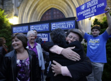 Campaigners embrace after a judge ruled that New Jersey is unconstitutionally denying federal benefits to gay couples.