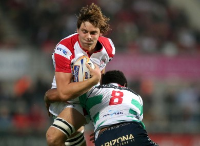 Ulster's Iain Henderson is tackled by Manoa Vosawai of Benetton Treviso.