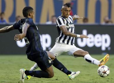 Juventus midfielder Arturo Vidal and Inter Milan defender Juan Jesus.