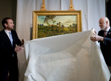 Axel Ruger and Louis van Tilborgh unveil the painting this morning.