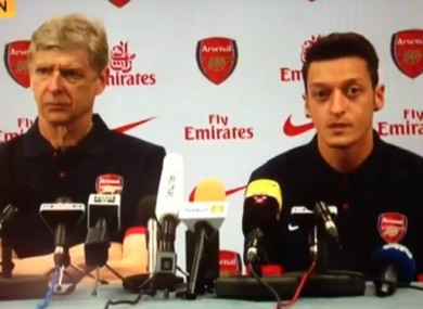 Ozil is unveiled alongside Wenger earlier today.