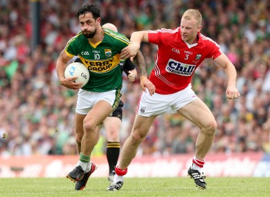 Paul Galvin and Michael Shields in action in this year's Munster final.