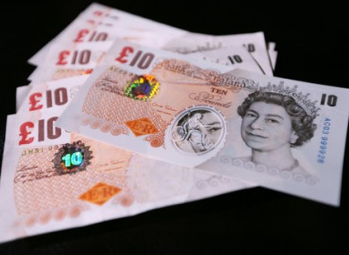 Samples of Polymer ten pound banknotes are shown during the news conference at the Bank of England in London