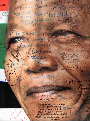 A portrait of former South African President Nelson Mandela with get well messages outside the Mediclinic Heart Hospital.