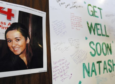 2010 file photo of a 'get well' message posted for Natasha in the Chicago bar where she worked