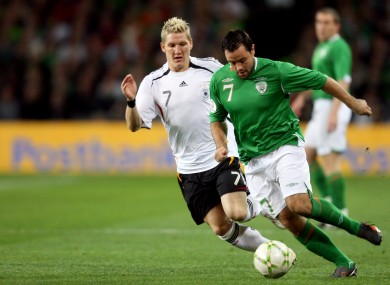 Bastian Schweinsteiger of Germany with Andy Reid of Ireland in 2007.