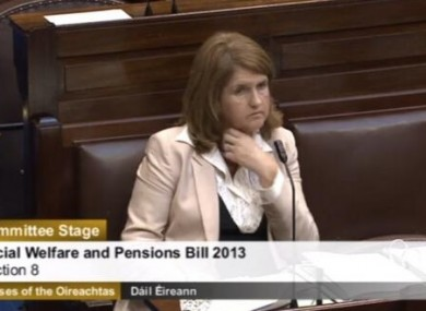 Joan Burton listens to arguments against cutting the bereavement grant