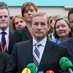 Kenny, flanked by Kieran O'Donnell (left) and Patrick O'Donovan speaks to the press <span class=