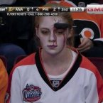Ok she's not a sport star, but this fan at Anaheim Ducks vs Philadelphia Flyers deserves a tip of the hat.