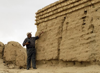 a guide at the site of the ancient city of Babylon in southern Iraq, where the city's famed Ishtar gate and a 2,500-year-old temple lies.