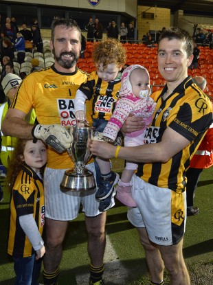 Crossmaglen's Paul Hearty with his children Breanne and Oran and Stephen Kernan with his daughter Sophie.