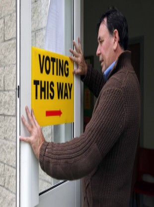 George Higgins puts the finishing touches on the polling station at St Joseph's Boys N.S. in Terenure, Dublin