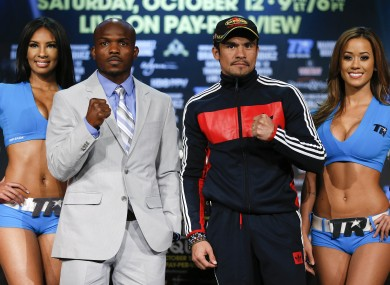 Timothy Bradley, second from left, and Juan Manuel Marquez pose for photos after a news conference in Las Vegas. The two boxers meet Saturday for Bradley's WBO welterweight title.