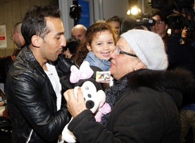 Belounis with his daughter and mother at Charles de Gaulle Airport today.