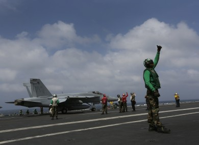 An F/A-18 Super Hornet prepares to take off from the deck of the USS George Washington