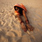 A Hindu woman devotee makes her way towards the Kathajodi River in a prostrating position as part of rituals during Chhath Puja festival near Cuttack. Chhath prayers, an ancient Hindu festival popular amongst the working class, is performed to thank the Sun God for sustaining life on earth. <span class=