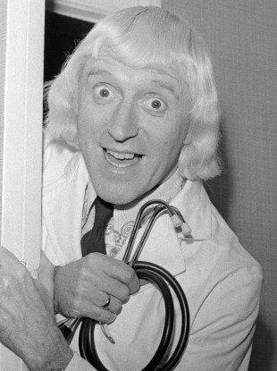 Jimmy Savile visits the patients and staff of Leeds General Infirmary in 1972.