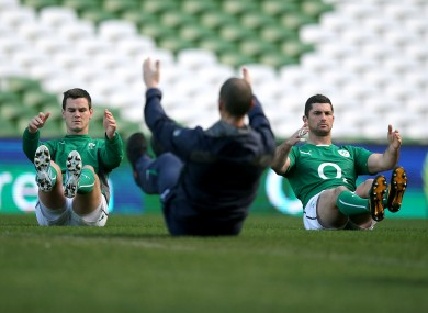 Rob Kearney and Jonny Sexton warm up at the Aviva Stadium today.