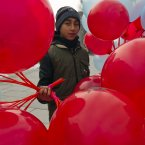 Kosovo Albanian boy sells balloons in the main square imprinted with Albanian flag eagle symbol in capital Pristina, Kosovo. This year, Albania marks 101 years of modern statehood by commemorating the November 28,1912 declaration of independence from the Ottoman empire. <span class=