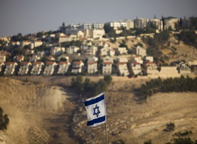 An Israeli flag is seen in front of the West Bank Jewish settlement of Maaleh Adumim on the outskirts of Jerusalem.