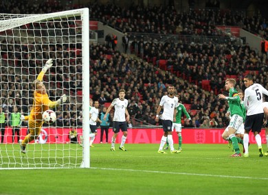 England goalkeeper Joe Hart fails to stop a header from Germany's Per Mertesacker (right) for their opening goal of the game.