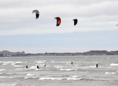 Five kite-surfers at Dollymount Beach, Dublin