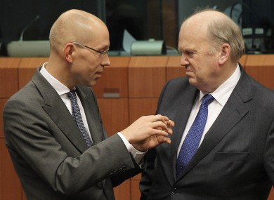 Finance Minister Michael Noonan speaks with Jorg Asmussen of the European Central Bank in Brussels last month