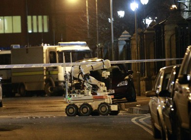 An army robot arrives at the scene close to a small explosion in the Cathedral Quarter in Belfast.