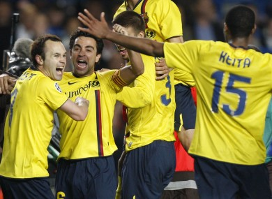Barcelona's Andres Iniesta, left, celebrates with his Barca teammates in 2009.