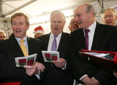 Enda Kenny, Peter Mathews and Senator Paddy Burke in full song in carol singing outside Leinster House this week