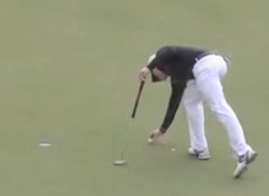 Dyson tapping down on the line of his putt, the move that resulted in today's ruling.