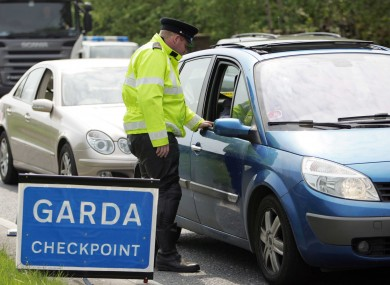 File photo of a car stopped at a Garda Checkpoint.