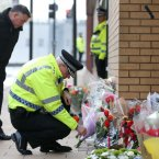 Chief Superintendant Andy Bates (right) Divisional Commander for Greater Glasgow with Scottish Fire and Rescue's Area Commander for Glasgow George McGrandles lay flowers near the Clutha bar helicopter crash scene in Glasgow.<span class=